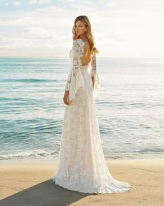 Wedding Dress GENISTA by Aire Barcelona - Search our photo gallery for pictures of wedding dresses by Aire Barcelona. Find the perfect dress with recent Aire Barcelona photos. Garden Wedding Dresses, Bohemian Wedding Dresses, Long Wedding Dresses, Bridal Dresses, Wedding Gowns, Bohemian Weddings, Bohemian Bride, Indian Weddings, Long Sleeve Wedding Dress Boho