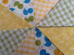 5 Metres - Beautiful spring fabrics; gingham, daisies, marbled yellow and little spring chickens. Couldn't be any cuter! Each flag is double sided so that you can hang the bunting any way you wish.