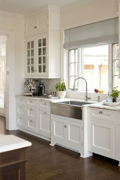 farm sink, white cabinetry and wood floors is all a must in my kitchen reno