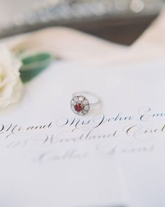 All engagement rings are beautiful, but with a romantic, red ruby, this one has an extra dose of wow! | Photography: @allentsaiphoto | Stationery: @nicoleblackcalligraphy | Cake: @honeylovecakery | Film Processing: @goodmanfilmlab | Venue: @flyingvranchtx