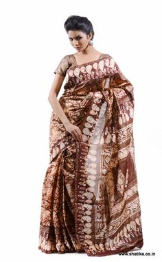 Mekhala Batik Print Pure Banarasi Silk Saree is a pure silk saree themed around batik prints. In shades of brown, the famous Batik print all over the body of the saree looks awe inspiring. See the look of the saree change as you team it up with different blouses for different occasions and of course matching accessories to go with it.