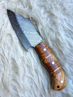 Hey, I found this really awesome Etsy listing at http://www.etsy.com/listing/152893892/damascus-steel-handmade-knife-dagger