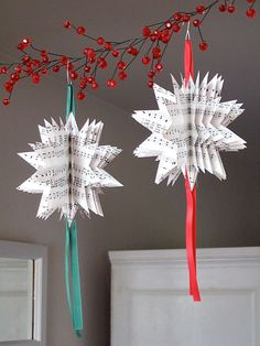 """Monica says we can use any symmetrical shape to create paper ornaments like these. She made four patterns (star, bell, angel and ball) complete with the sheet music motif for us to download. To make them, we'll need the following: ribbon, 3/8"""" wide white paper black thread Monica's pattern of our choosing ornamental hook scissors sewing machine (yup, they're sewn) ruler stapler (optional) For the entire tute, and for links to the individual patterns, head on over tothis post at CraftyNest."""
