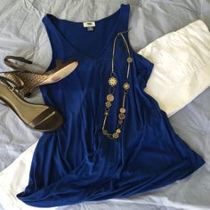 New ListingOld Navy Draped Blue Tank Top Beautiful Royal Blue V-neck Tank Top has a soft  crossover drape at hemline. Racerback style. Rayon material offers soft, lightweight comfort. Worn once & in EUC. Old Navy Tops Tank Tops