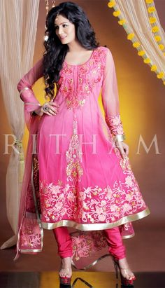 Pink net anarkali style churidar kameez is nicely designed with resham, zari, lace and gotta patti work. Beautiful pink and golden color embroidered neckline and bottom of the suit is highlighting the beauty of the kameez. Matching churidar and net dupatta is available with this.