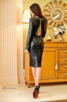 Black leather open back top and leather skirt ensemble