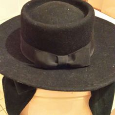 Gorgeous black hat Black wool hat with straps to tie. Black bow on back. Will give any outfit a classy look. Excellent condition Accessories Hats