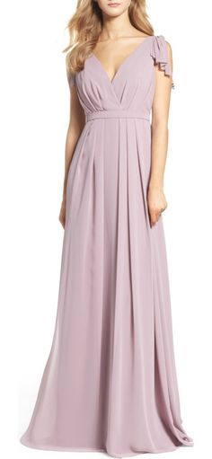 sleeveless deep v-neck chiffon gown by Monique Lhuillier Bridesmaids. Pleated details at the shoulders add fluttery, feminine movement to this dreamy chiffon gown styled with a deep surpl...