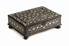 AN ANGLO-INDIAN EBONY AND ENGRAVED IVORY CASKET