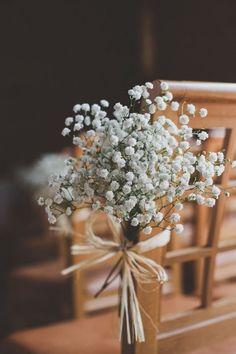 Baby's Breath Floral Chair Decoration | Ceremony aisle decor for a rustic wedding #weddingdecoration