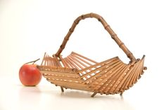 Vintage Wood fruit bowl basket bamboo table center by Brocantebcn Pins Vintage, Vintage Wood, Bamboo Table, Wood Table, Indoor Wicker Furniture, Fruit Holder, Home Decor Shelves, Outdoor Sofa Sets, Wicker Mirror