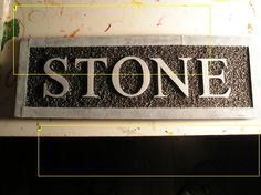 DIY fake stone sign out of foam and spray paint