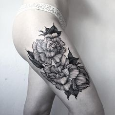 So sick!! This is kind of how I want my rib tattoo to be but with calalilies!