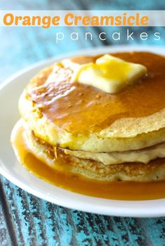 Orange Creamsicle Pancakes - These Orange Creamsicle Pancakes are everything you love about creamsicles, in breakfast form.  The pancakes are orange infused, sandwiched with a rich, sweet, creamy filling.  But the best part of all is our Aunt Lana's famous tangy orange syrup, it was always a special treat when we would get this syrup growing up, it is oh so yummy.