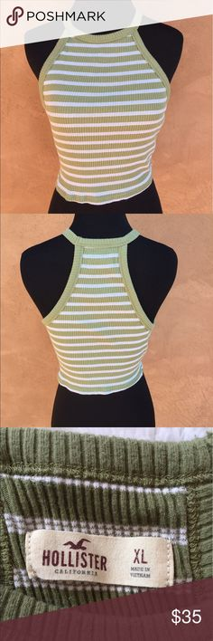 """Hollister striped halter crop top Hollister crop top. EUC. Halter neck style in back and front. Green with white horizontal stripes. Bust approx 30"""" (material has a bit of stretch), length approx 16 3/4th"""". 96% cotton, 4% elastane. Please feel free to ask any questions or submit offers if interested! Hollister Tops Crop Tops"""