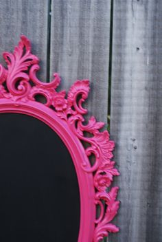 Black board in bright ornate frame. Love it!