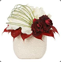 Red and white modern arrangement by Tic Tock Couture Florals via Botanical Brouhaha.