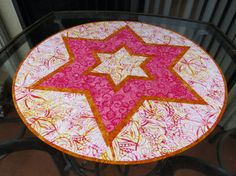 Round Quilted Batik Table Topper Star Orange 630 by QuiltinWaYnE #etsyhandmade #etsyquilter #quiltedtabledecor