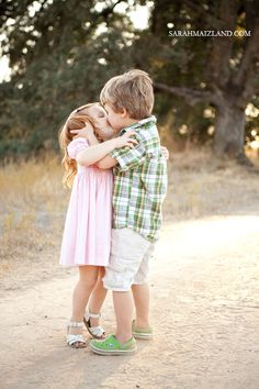 This little boy already knows how to kiss a girl! Love this
