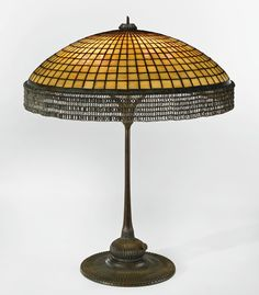 "Tiffany Studios | A RARE ""PARASOL"" CHAINMAIL TABLE LAMP shade impressed TIFFANY STUDIOS/NEW YORK base impressed TIFFANY STUDIOS/NEW YORK/3276 leaded glass and patinated bronze 30 1/2  in. (77.5 cm) high 25 1/4  in. (64.1 cm) diameter of shade circa 1905 