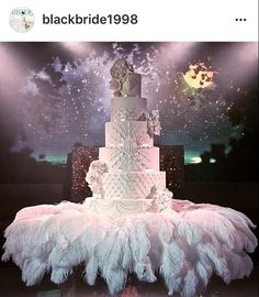 Over the top all white wedding cake