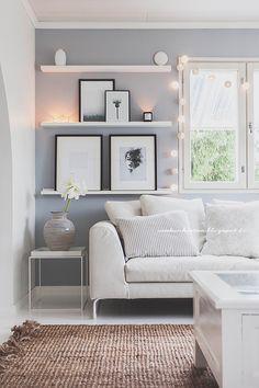 living room shelves beside the window