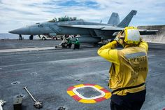 "SOUTH CHINA SEA (June 21, 2014) Aviation Boatswain's Mate (Handling) 3rd Class Tenesha Carney, from Murfreesboro, Tenn., signals the pilot of an F/A-18F Super Hornet from the ""Diamondbacks"" of Strike Fighter Squadron (VFA) 102 as it prepares to launch from the flight deck of the U.S. Navy's forward-deployed aircraft carrier USS George Washington (CVN 73). (U.S. Navy photo by Mass Communication Specialist 3rd Chris Cavagnaro/Released)"