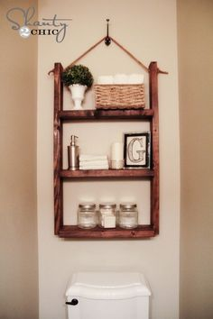 Hanging Bathroom Shelf tutorial by Shanty2Chic. Find their tutorial with RYOBI tools here: http://www.shanty-2-chic.com/2013/08/bathroom-shelf.html