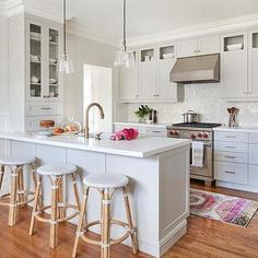 Light Gray Kitchen Peninsula with Backless Bistro Stools