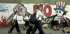School children pass a mural depicting the U.S.'s Uncle Sam adorned with swastikas and reading 'No to imperialism' in Caracas, Venezuela, Tuesday, Feb. 7, 2006.  Venezuela remains a major supplier of oil to the United States, but political tensions have been particularly severe as Venezuela investigates whether various military attaches at the U.S. Embassy were involved in an espionage case that already prompted the expulsion of one American official.  Picture: AP/Leslie Mazoch