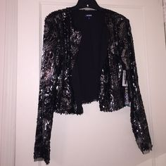 Cropped sequence jacket Black & silver sequence, open front, never worn w/ tags Tildon Jackets & Coats Blazers