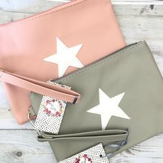 The Zelly faux leather star clutch purse in pink or grey is an ideal fashionable accessory. It is fully lined with an internal zip pocket and useful wrist strap. Handmade Cosmetics, Clutch Bags, Wash Bags, Gold Stars, Cosmetic Bag, Purses And Bags, Fashion Accessories, Pouch, Gift Ideas