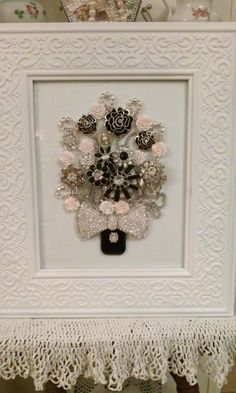 vintage jewelry bouquet of rhinestone and enamel pieces and seed bead bow, a very nice accent, also use of rhinestone cup chain as a negative space accent, adds a lot of interest