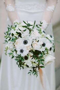 White and blush wedding bouquet. Photography by http://davidjenkinsphotography.com/