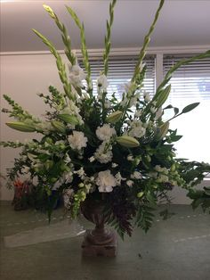 Large arrangement. White and greens.