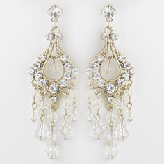 A lovely classic inspired gold and crystals chandelier earrings that feature clear rhinestones and Austrian crystals that dangle beautifully on these gold plated earrings. These earrings are alluring