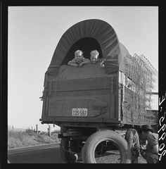 Just arrived from Kansas. On highway going to potato harvest. Near Merrill, Klamath County, Oregon. By Dorothea Lange.