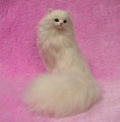 Needle felted odd-eyed cat with long hair.  It is said that the cat of odd-eye brings luck.  This cat is so soft, needle felted of fine wool.
