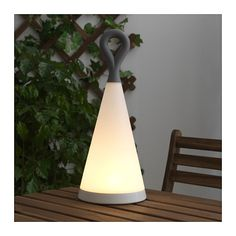 SOLVINDEN LED solar-powered table lamp IKEA The rechargeable battery is hidden inside the lamp shade to protect it from water.