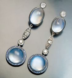 Antique Moonstone Sapphire and Diamond Pendant Earrings Circa 1915. Silver topped 14K gold cabochon cut blue moonstones calibre cut blue sapphires old cut diamonds