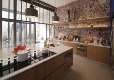 Raw materials and perfect finishings. Old meets new in this #brick #kitchen