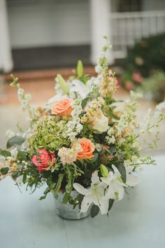 Simple rustic gorgeousness - pink, peach, green, and white unstructured arrangement all nestled into the perfect galvanized bucket #cedarwoodweddings Rustic Pastel Wedding :: Sydney+Nick   Cedarwood Weddings