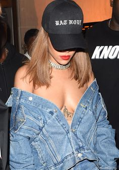 Dangerously low: Rihanna turned her Balenciaga denim jacket into an off-the-shoulder, cleavage-baring top
