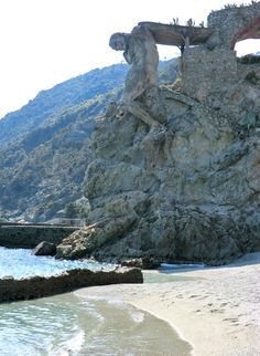 Hercules carved into the mountain. Monte rosso al Mare, Cinque Terre, Italy. The sculpture was part of a Villa destroyed during WW2, Liguria