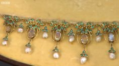 Jessie M King for Liberty & Co. Moonstone, pearl and enamel necklace, c. 1905. View 3/5.