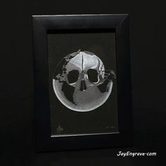 This design is from the album Oxygene by french composer, Jean Michel Jarre. This glass engraving was done by hand using a micromotor and took over 12 hours to complete. Hand engraved and framed with black fabric inside. Frame Size: 6 x 4 (Inches) Frame Color: Black Frame Material: Wood Like all my engravings, each one is unique, individually numbered, initialed and comes with a JayEngrave COA. Catalogue Serial Number: 41-01-50 Looking for gift ideas? These framed hand engravings make ideal… Glass Engraving, Hand Engraving, Jean Michel, Frame Sizes, Framing Materials, Black Fabric, Initials, Color Black, Skull