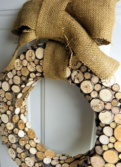 Wreath made from dried wood twigs cut into 1/4 slices and  hot glued to styroform wreath.  ( A straw wreath wrapped in brown ribbon or felt could be also used.)