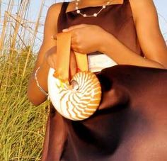A nautilus shell to hold petals for the flower girl.  So cute and memorable!