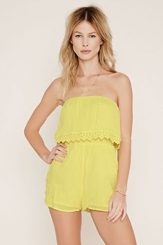 This crinkled woven crepe romper features an elasticized smocked waist, a strapless neckline with a crochet-trimmed flounce layer and crochet inserts at the hem.