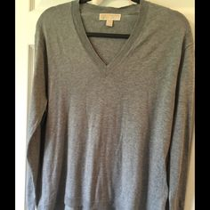 MK light weight gray sweater S 55%cotton 37%viscose 8%nylon  Soft and warm for spring. Lightweight long sleeve gray sweater A little longer in back Michael Kors Sweaters V-Necks